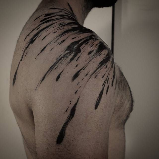 Abstract brush stroke tattoo on the right shoulder. Tattoo Artist: GAKKIN