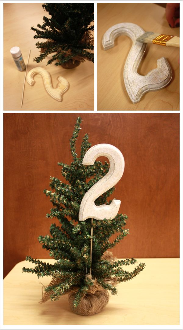Easy DIY pine tree table numbers for a winter wonderland or christmas wedding  This might be a good way to incorporate the little christmas trees you guys liked from Grey's Anatomy.