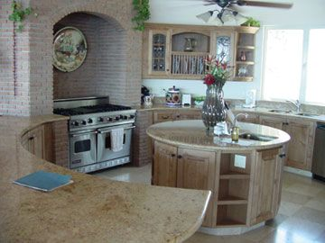 Round central kitchen with dining and living areas open.