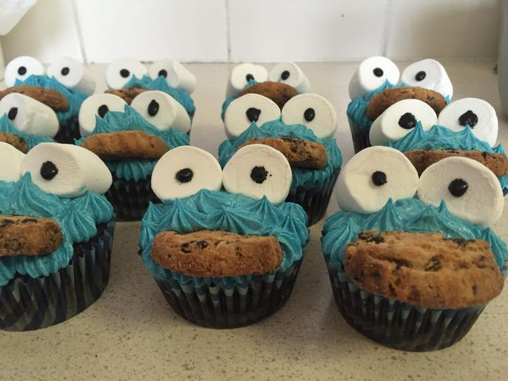 Cookie monster cupcakes - while these looked really hard to do they were actually very easy - vanilla cupcake filled with blueberry jam, topped with bright blue tinted buttercream, marshmallows for eyes and eyeballs drawn on using black gel then half a chocolate chip cookie inserted into the frosting....I found the trick to this was to cut a small incision into the cupcake where you want the cookie to sit, then pipe the frosting under where you want the cookie to go.