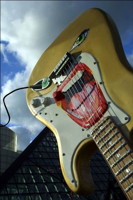 Guitar exhibit outside Rock and Roll Museum and Hall of Fame