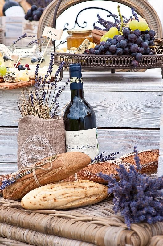 Wine, baguette, assortment of fruits and cheeses