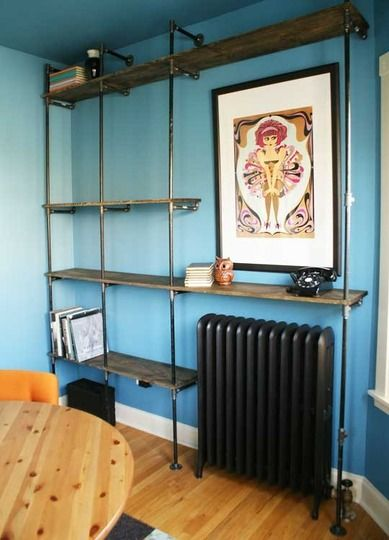 "want to make a wall of shelves near the ""work space"" side of the living room.  love these shelves made from plumbing fixtures! (the fiancé's dad is a plumber so how perfect...)"