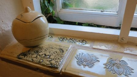 Tiles in window - pressed decoration - by Bella Odendaal