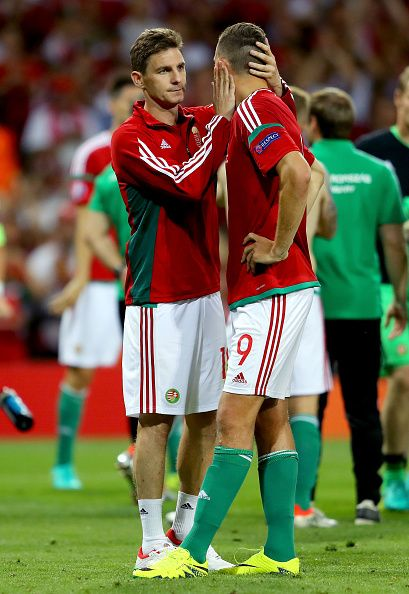 #EURO2016 Adam Szalai of Hungary is consoled by his tam mate Zoltan Gera during the UEFA EURO 2016 round of 16 match between Hungary and Belgium at Stadium...