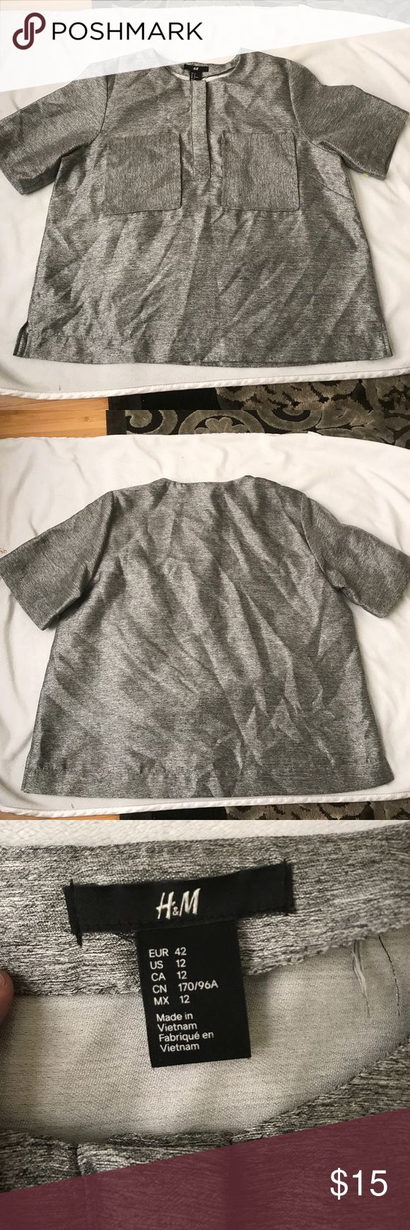 Metalic short sleeve top Light weight side slit half Button front short sleeve top. Fun metallic fabric dress up jeans or wear to the office! H&M Tops Blouses