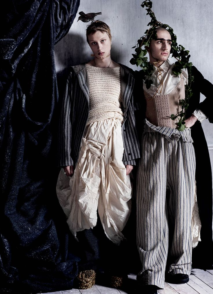 ANDREY WEARS JACKET CRAIG GREEN TOP AND PANTS LOEWE SKIRT ELENA DAWSON SLIPPERS EGG HEADPIECE NAOMI GOODSIR ANDY WEARS COAT AND SHIRT ELENA DAWSON CORSET AND EARRINGS HIS OWN PANTS CRAIG GREEN SHOES LOEWE