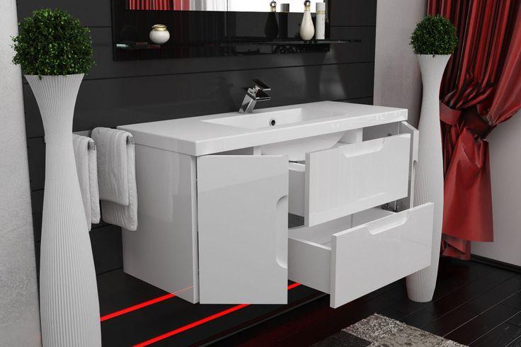 Dzięki wykorzystaniu miejsca w szafce umywalkowej w łazience zostaje przestrzeń na stylowe dodatki.
