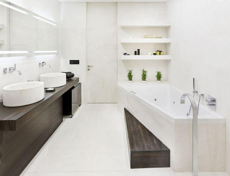 Modern Minimalist Apartment Bathroom Interior Design With Elegant White  Asymmetric Bathtub And Round White Marble Washbasin