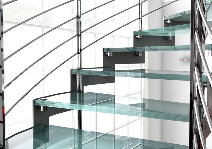 Detalle escalera en acero inoxidable con peldaños de cristal, muy luminosa
