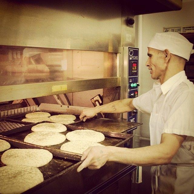 Meet @Rustic Sourdough Bakery Baker Ezzedini making today's focaccia bread. #yyc