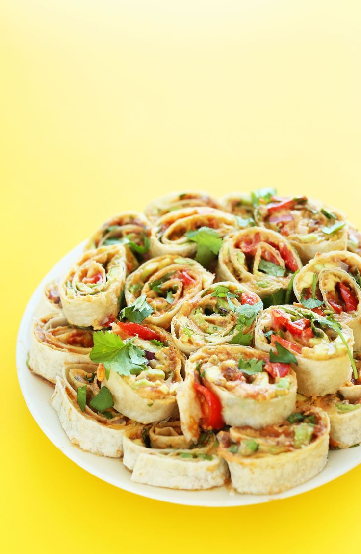 Mexican Pinwheels with Refried Beans, Avocado, Onion, Cilantro and Tomato