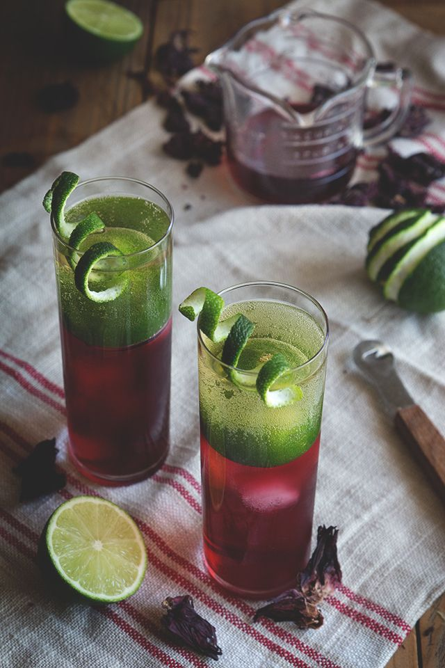 Hibiscus Rum Buck - White Rum, Hibiscus Syrup (Recipe), Lime Juice, Ginger Beer, Lime Twist for Garnish.