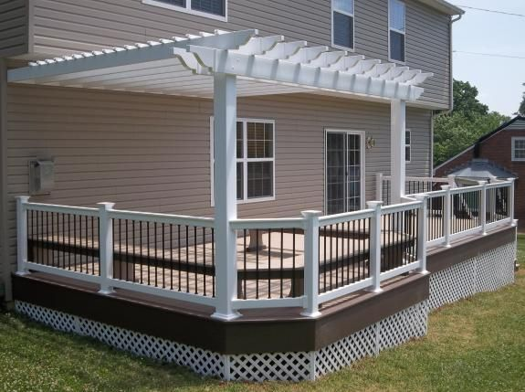 White Vinyl pergola and railings on an Azek Brownstone deck with Acacia border