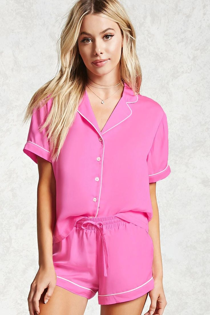 A satin PJ set featuring a button-up shirt with a notched collar and short sleeves, as well as shorts with a dolphin hem, contrast trim, and an elasticized drawstring waist.