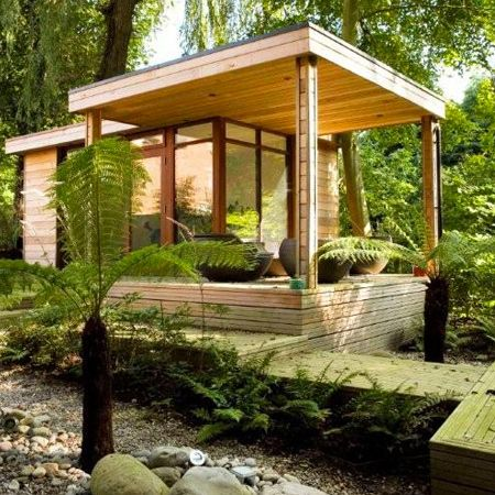 Tiny house in the woods with a covered porch