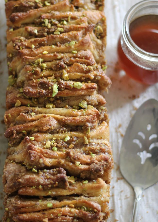 Baklava Pull Apart Bread - A rich, moist and nutty dessert bread layered with pistachios, walnuts, honey and cinnamon sugar.: