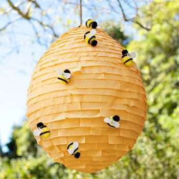 Just too precious! This bumblebee piñata is a DIY tutorial over at Country Living, with instructions for both the hive and the bees. The piñata starts with an oversized balloon, and overall it only costs $10 to make the whole project – bees and all! ...