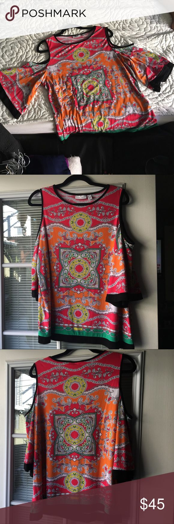 Women top Susan Graver, Size L,  95% polyester 5% spandex.  Print top.  Super cute.  Great for work or party.  No flaws.  Worn twice... in good shape. Susan Graver Tops Blouses