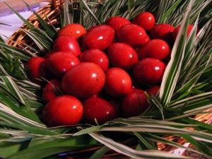 Russians dye their Easter eggs red to symbolize the blood of Christ.  Basekt of Red Easter Eggs on Palm branches