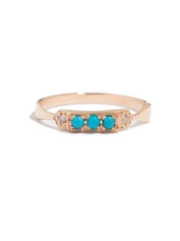 The Jamie Ring by Theresa M Lee features three 2mm turquoise stones hand set in middle shelf with champagne diamonds on each side. Elegant fine jewelry.