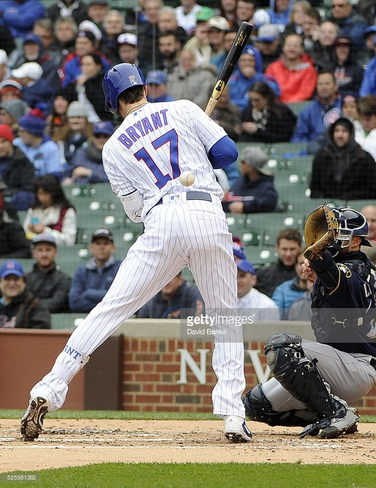 <a gi-track='captionPersonalityLinkClicked' href=/galleries/search?phrase=Kris+Bryant+-+Baseball+Player&family=editorial&specificpeople=14019446 ng-click='$event.stopPropagation()'>Kris Bryant</a> #17 of the Chicago Cubs is hit by a pitch against the Milwaukee Brewers during the first inning on April 28, 2016 at Wrigley Field in Chicago, Illinois.