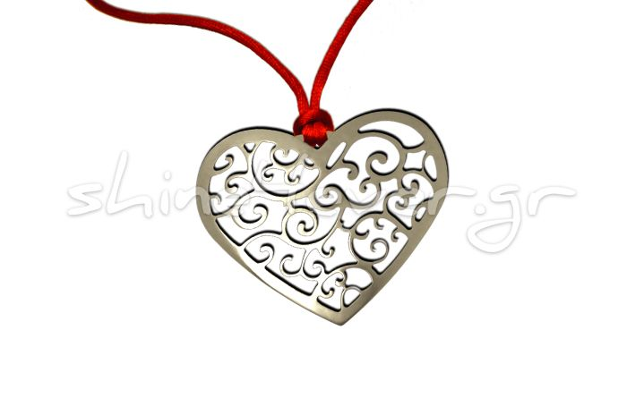 Silver Heart-shaped pendant with paisleys. By shine4ever.gr.