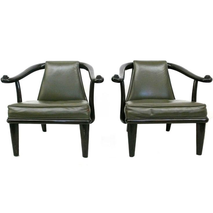 wood and leather armchairs by