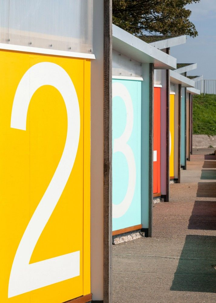 Facade sign for beach huts by Pedder & Scampton