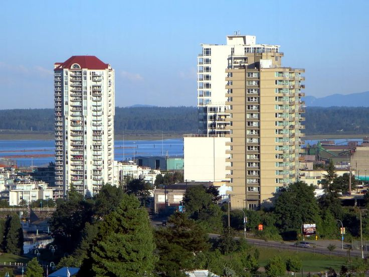 From left to right, the Beacon Tower (1994), Pacifica (2009), and Seacrest Apartments (1965) in downtown Nanaimo, British Columbia, Canada.