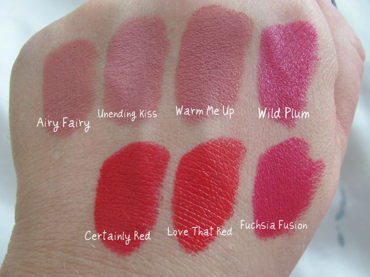 """In order from L-R: Rimmel """"Airy Fairy"""", Loreal """"Unending Kiss"""", Maybelline """"Warm Me Up"""", Loreal """"Wild Plum"""", Revlon """"Fuchsia Fusion"""", """"Love That Red"""", and """"Certainly Red""""."""