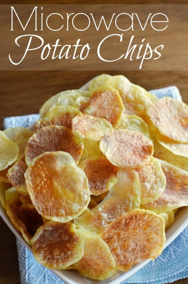 You don't need a deep fryer to get crispy potato chips.  We made these chips right in the microwave!  I bought one of those fancy microwave chip makers, but quickly realized a plate and parchment paper does the trick much better.  The silicone tray tray still gets used so I can layer and get two plates out at once.