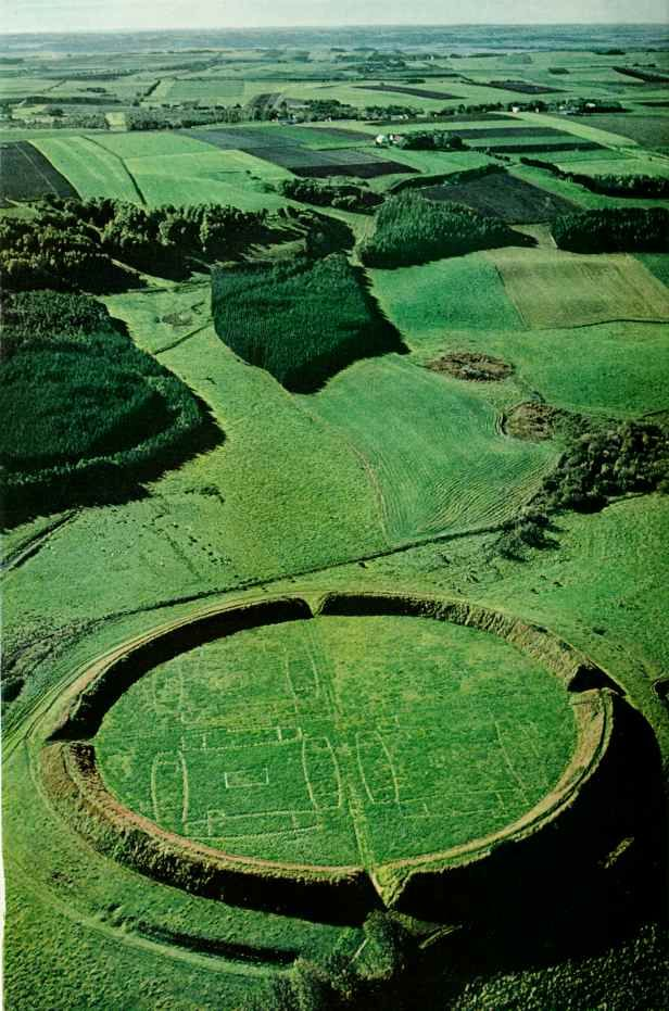 The Trelleborg near Slagelse on the Danish island of Zealand.  Similar to the other Viking ring castles found so far, it was designed as an exact circle with two roads that crossed at right angles in the geometric center and led to the four gates with two always opposite to each other. In each of the four quarters stood four almost identical longhouses arranged in a square.  The whole fortress may have supplied room for some 1,300 people.  It was contructed near the year 1000.