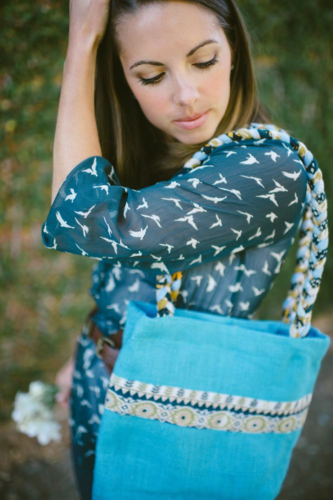The Hope bag is a perennial favorite from Freeset. Featuring braided sari handles and a sari strip on the outside, every bag is unique. It is available in 4 colors - Sky Blue (pictured), Parchment, Red and Black.   Photo by Calvina Photography