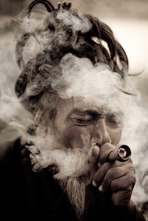 """A Hindu man is smoking ganja in chillum after Maha Shivaratri festival. This image is taken at Katmandu-Nepal."" by Binh Dang"