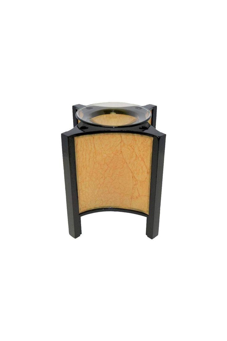"This Asian lantern style oil warmer uses one 35 watt halogen bulb (included). You can use either scented oils or tarts in this oil warmer. The 36"" power cord has a built in dial that allows you to adjust the heat and light. Turn it up to use as a lamp, turn it down for use as a night light. Attractive design compliments any style or decor.    This lamp measures 6.5"" tall and 6.25"" diameter.    Paper Lamp Warmer by Crafty Sisters Boutique. Home & Gifts - Home Decor New Jersey"