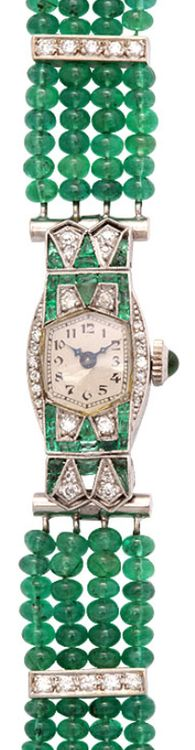 Art Deco Emerald & Diamond Longines Watch on Emerald Band, via 1stdibs. Perfect for evening attire, this elegant Art Deco diamond & emerald Longines platinum watch was later fitted with a custom band. The band has diamond spacers and a clasp with an emerald cabochon all set in 14k white gold. The rest of the band is four rows of emerald beads.
