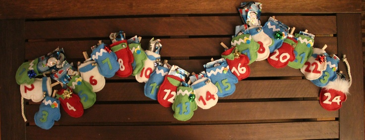 Advent Calendar preloaded with goodies sewn into wrapping paper pouches for nephews xmas present.