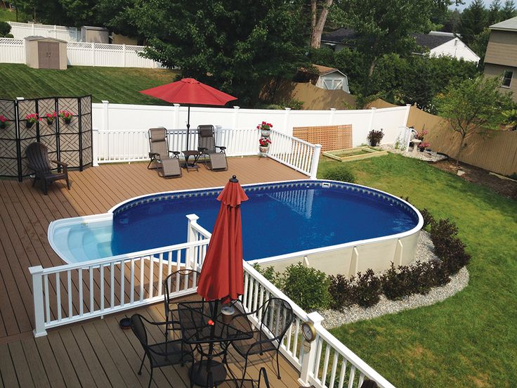 Radiant Metric Oval pool with deck and walk-in step is just perfect for this backyard retreat!