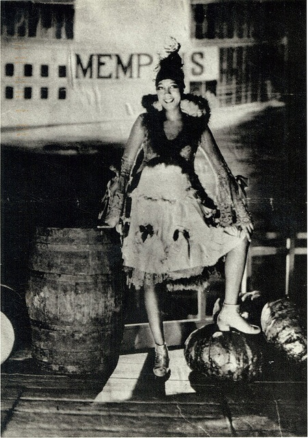 Josephine Baker in front of backdrop of steamboat named Memphis in La Revue Negre, Paris c. 1920s  Photo by: James Abbe
