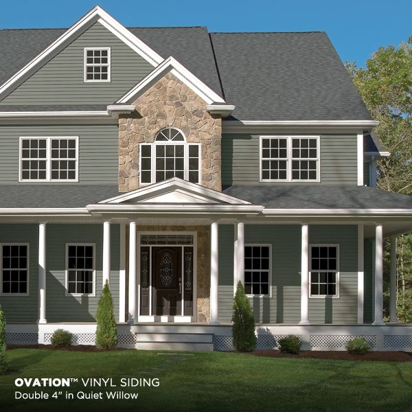 Green siding in Quiet Willow paired with a stone exterior - FaveThing.com
