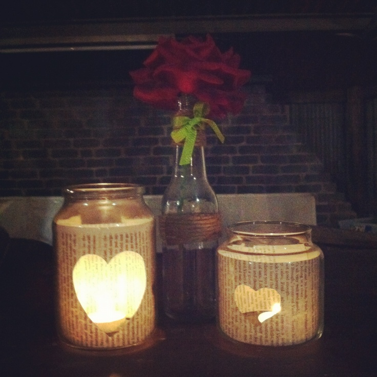 old jars with twine, ribbons, flowers and love hearts cut out of novel pages