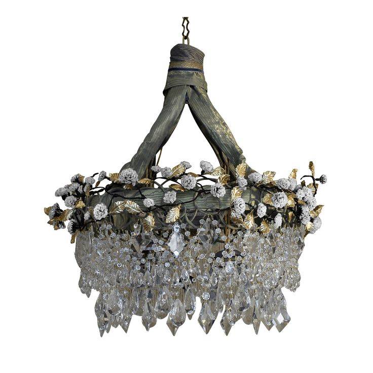 Rosalya Chandelier combines the eclectic use of fabric, glass, crystals, brass with 3,000 sequins attached to poetically evoke the branches of a delicate rose bush.