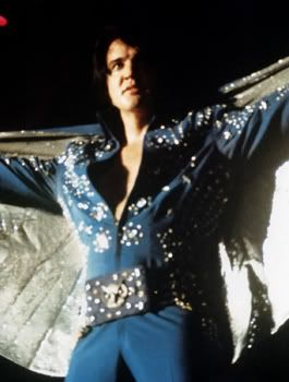 Elvis in Concert wearing Royal Blue Fireworks suit one of the jumpsuits worn during filming of 1972 film Elvis On Tour