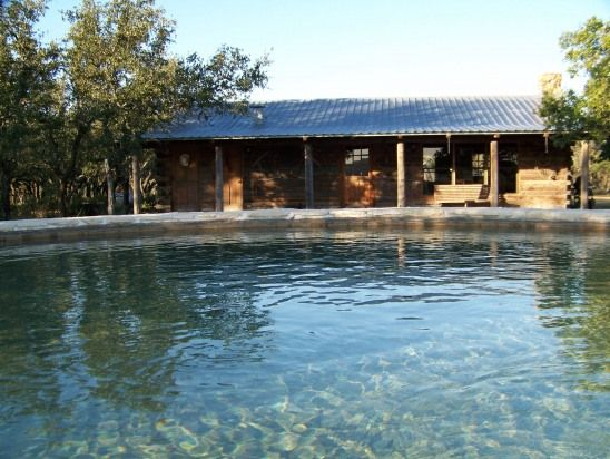 Texas hill country stone pool house texas at its best for Cabin rentals fredericksburg tx