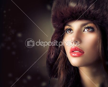 Beautiful Young Woman in a Fur Hat. Winter Style — Stock Image #20381645