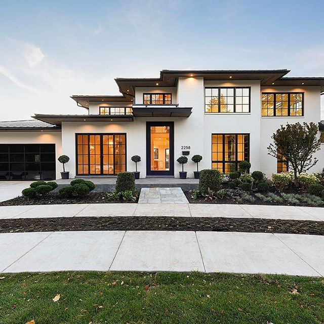 Modern Exterior Of Home With Pathway Transom Window: Modern White And Black Exterior. Black Windows, Painted