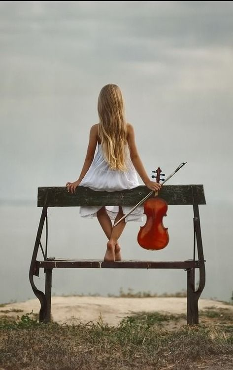 It's killing me that she's touching the hair and the strings are scraping the bench...but, cool pic anyway :) I'd turn the violin around and hold the bow differently