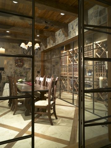 glassed-in wine tasting room inside a huge wine cellar...