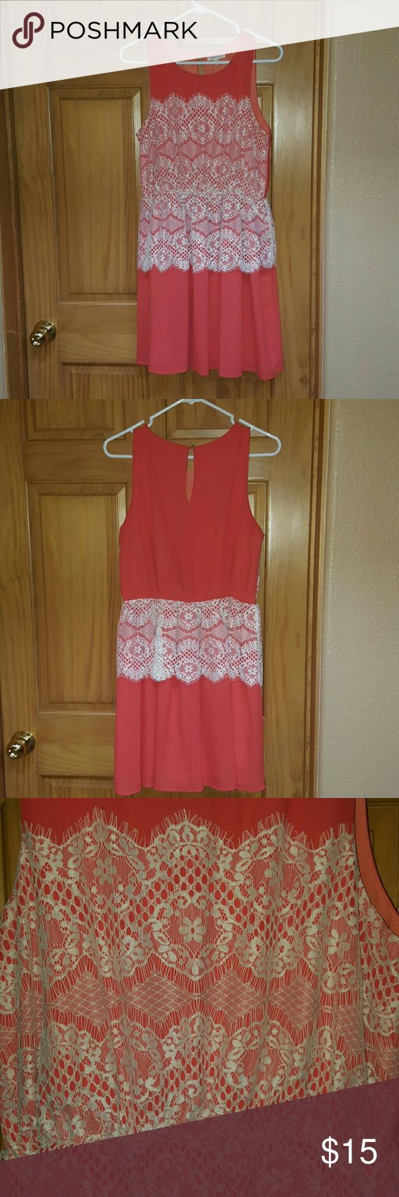 Pretty coral & lace dress! Very pretty coral and lace dress. Elastic waist so the dress cinches your waist when on. Keyhole button on back. Can dress up or down. Looks great belted. under skies Dresses